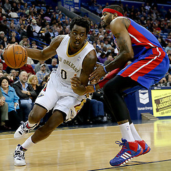 Dec 11, 2013; New Orleans, LA, USA; New Orleans Pelicans small forward Al-Farouq Aminu (0) drives past Detroit Pistons small forward Josh Smith (6) during the second quarter at New Orleans Arena. Mandatory Credit: Derick E. Hingle-USA TODAY Sports