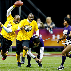 Jan 31, 2013; New Orleans, LA, USA; AFC squad Torry Holt runs against the NFC squad during the Tazon Latino VII flag football game at Clinic Field  inside the Ernest Morial Convention center. Super Bowl XLVII will take place between the San Francisco 49ers and the Baltimore Ravens on February 3, 2013 at the Mercedes-Benz Superdome.  Mandatory Credit: Derick E. Hingle-USA TODAY Sports