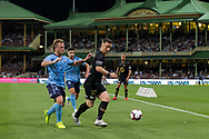 SYDNEY, AUSTRALIA - OCTOBER 27: Western Sydney Wanderers midfielder Alexander Baumjohann (10) shields the ball from Sydney FC defender Rhyan Grant (23) at The Hyundai A-League Round 1 soccer match between Sydney FC and Western Sydney Wanderers FC The Sydney Cricket Ground in Sydney on October 27, 2018. (Photo by Speed Media/Icon Sportswire)