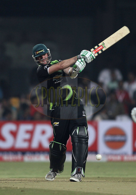 Jon-Jon Smuts of the Warriors pulls a delivery during match 1 of the NOKIA Champions League T20 ( CLT20 )between the Royal Challengers Bangalore and the Warriors held at the  M.Chinnaswamy Stadium in Bangalore , Karnataka, India on the 23rd September 2011..Photo by Shaun Roy/BCCI/SPORTZPICS