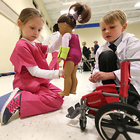 Adam Robison | BUY AT PHOTOS.DJOURNAL.COM<br /> Addison Stanford, 6, dressed as a physical therapist and Aiken Cullun, 6, dressed as a pharmacist, both first graders in Mrs. Korrie Smith's tiger time reading group, give care and aide to Addison's patient Addie the doll. The two are dressed as career porfessionals for the Saltillo Primary School wax museum where they presented information about their chosen career path. The event is part of an almost $41,000 grant to Lee County Schools from the Toyota Wellspring Education Fund that focuses on a career awareness and readiness.