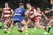 Ben Flower of Wigan Warriors and Joe Philbin of Warrington Wolves in action during the Betfred Super League Grand Final at Old Trafford, Manchester.<br /> Picture by Michael Sedgwick/Focus Images Ltd +44 7900 363072<br /> 13/10/2018