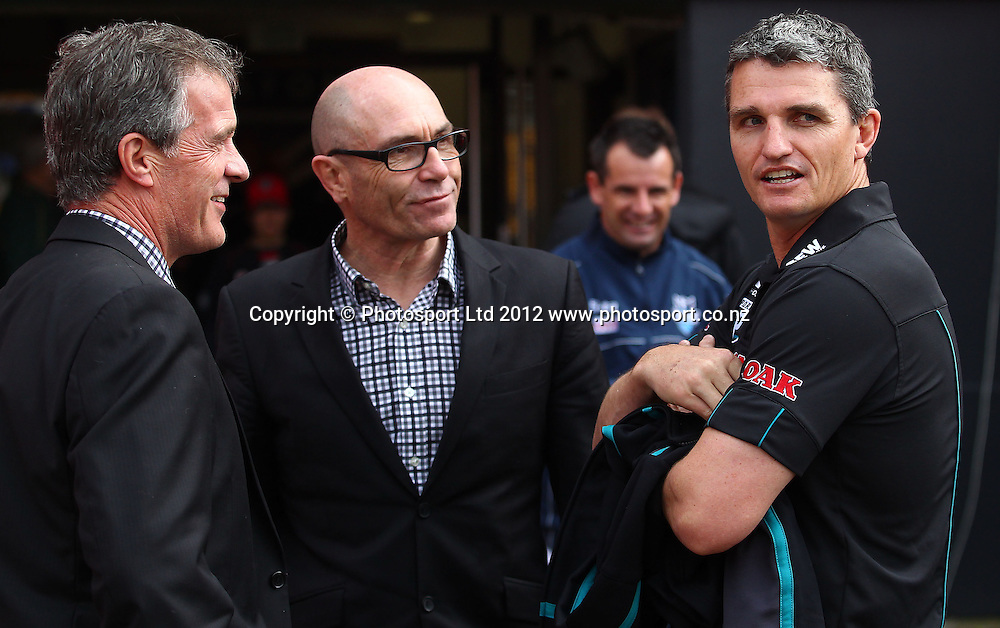 Panthers coach Ivan Cleary (R) talks to Junior Warriors coach John Ackland (C) and Warriors media manager Richard Becht during the NRL game, Vodafone Warriors v Penrith Panthers, Mt Smart Stadium, Auckland, Sunday 19 August  2012. Photo: Simon Watts /photosport.co.nz