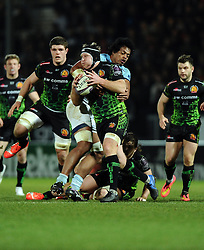 Exeter Chiefs' Number 8, Thomas Waldrom is tackled  - Photo mandatory by-line: Joe Meredith/JMP - Mobile: 07966 386802 - 24/01/2015 - SPORT - Rugby - Exeter - Sandy Park Stadium - Exeter Chiefs v Bayonne - Challenge Cup Round 6