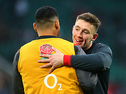 Josh Adams of Wales hugs Worcester Warriors teammate Ben Te'o of England ahead of their side's Six Nations match - Mandatory by-line: Robbie Stephenson/JMP - 10/02/2018 - RUGBY - Twickenham Stoop - London, England - England v Wales - Women's Six Nations