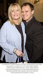 TV presenter GABBY ROSLIN and her husband MR COLIN PEEL, at a party in London on 13th March 2001.OMD 4