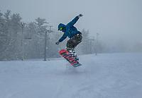 This snowboarder getting some fresh powder runs at Gunstock Mountain on Tuesday.  (Karen Bobotas/for the Laconia Daily Sun)