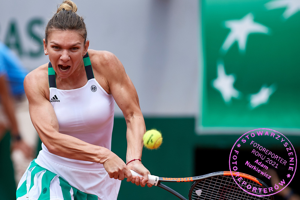 Paris, France - 2017 June 03: Simona Halep from Romania plays a backhand while her women's single match third round during tennis Grand Slam tournament The French Open 2017 (also called Roland Garros) at Stade Roland Garros on June 03, 2017 in Paris, France.<br /> <br /> Mandatory credit:<br /> Photo by &copy; Adam Nurkiewicz<br /> <br /> Adam Nurkiewicz declares that he has no rights to the image of people at the photographs of his authorship.<br /> <br /> Picture also available in RAW (NEF) or TIFF format on special request.<br /> <br /> Any editorial, commercial or promotional use requires written permission from the author of image.