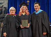 Houston ISD Superintendent Richard Carranza presents Liliana Ehrhart with a Board Award during the Furr / Reach High School graduation in Delmar Fieldhouse, May 26, 2017. The ceremony was the first graduation to be held in the newly constructed facility.