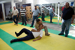 Mario Falcone, director of the boyd guard training school Falcone's System International, teaches a course to men who will be the bodyguards for the incoming mayor of Ciudad Victora.