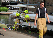 © licensed to London News Pictures. MARLOW, UK.  03/08/11. A fireman walks past boats. Marlow Rowing Club has been badly damaged by fire today (03 August 2011). Boats with an estimated value of 100,000 pounds have been damaged. Steve Redgrave, Olympic Rower, who trained at the club and is from Marlow said his daughters boat is believed to be inside.  Mandatory Credit Stephen Simpson/LNP