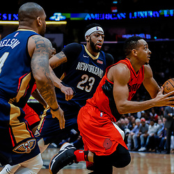 Jan 12, 2018; New Orleans, LA, USA; Portland Trail Blazers guard Damian Lillard (0) drives past New Orleans Pelicans forward Anthony Davis (23) during the second half at the Smoothie King Center. The Pelicans defeated the Trail Blazers 119-113. Mandatory Credit: Derick E. Hingle-USA TODAY Sports