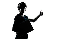 one caucasian young teenager silhouette boy girl holding carrying laptop computer thumb up portrait in studio cut out isolated on white background