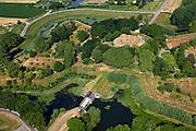 Nederland, Gelderland, Neder-Betuwe, 08-07-2010; fort Everdingen aan de Lek, onderdeel van de Nieuwe Hollandse Waterlinie, begin van de Diefdijk (boven). Onder in beeld de stuw / sluis die voor  het innunderen gebruikt werd. De Explosieven Opruimings Dienst (EOD) maakt nog gebruik van het complex..Fort Everdingen near river Lek, part of the New Dutch Waterline..luchtfoto (toeslag), aerial photo (additional fee required).foto/photo Siebe Swart