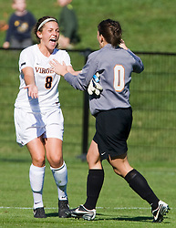 Virginia Cavaliers midfielder/defender Alli Fries (8) celebrates with Virginia Cavaliers goalkeeper Celeste Miles (0) after defeating BC.  The #9 ranked Virginia Cavaliers defeated the #13 ranked Boston College Eagles 2-1 in NCAA women's soccer at Klockner Stadium on the Grounds of the University of Virginia in Charlottesville, VA on October 19, 2008.