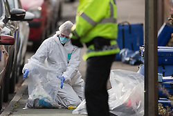 © Licensed to London News Pictures . 25/10/2015 . Stockport , UK . Police and forensic scenes of crime investigators at the scene on Ash Street , Stockport , where Greater Manchester Police report a man was stabbed to death in the street last night (24th October 2015) . Two people have been arrested . Photo credit : Joel Goodman/LNP