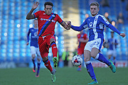 Nathaniel Mendez-Laing challenged by Lawrence Maguire during the EFL Sky Bet League 1 match between Chesterfield and Rochdale at the b2net stadium, Chesterfield, England on 25 March 2017. Photo by Daniel Youngs.