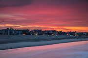 A fiery sunrise colors the sky red over Venice Beach, Venice, California.