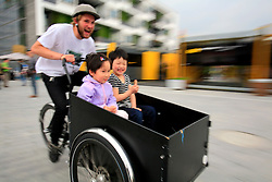 CHINA PUDONG DISTRICT SHANGHAI 23MAY10 - Danish cyclist takes Chinese children for a tour at the Expo 2010 in Shanghai, China...jre/Photo by Jiri Rezac..© Jiri Rezac 2010