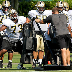 August 6, 2011; Metairie, LA, USA; New Orleans Saints guard Jahri Evans (73) works on a sled drill during training camp practice at the New Orleans Saints practice facility. Mandatory Credit: Derick E. Hingle
