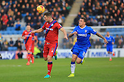 Harrison McGahey heads under pressure from Cody McDonald during the EFL Sky Bet League 1 match between Gillingham and Rochdale at the MEMS Priestfield Stadium, Gillingham, England on 26 November 2016. Photo by Daniel Youngs.