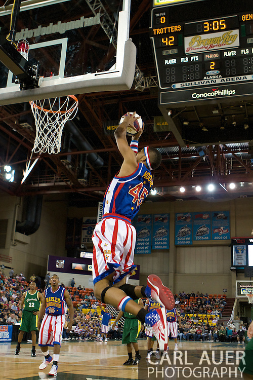 April 30th, 2010 - Anchorage, Alaska:  Harlem Globetrotter Moose (45)grabs the ally-oop pass from Buckets Blakes (15) for a dunk on Friday night at the Sullivan Arena.
