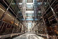Walkway between glass buildings in downtown Washington, D.C. Copyright 2015 Reid McNally.