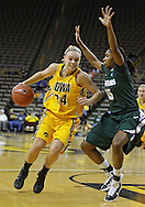 January 27 2010: Iowa guard Jaime Printy (24) drives around Michigan St. forward Cetera Washington (15) during the first half of an NCAA women's college basketball game at Carver-Hawkeye Arena in Iowa City, Iowa on January 27, 2010. Iowa defeated Michigan State 66-64.