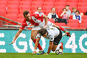 Adam Mekki of Bromley FC (11) and Matt Lowe of Brackley Town (2) battle for the ball during the FA Trophy match between Brackley Town and Bromley at Wembley Stadium, London, England on 20 May 2018. Picture by Stephen Wright.