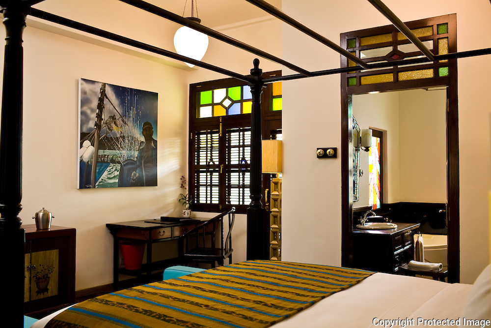 typical guest room with original works of art at the Penaga Hotel