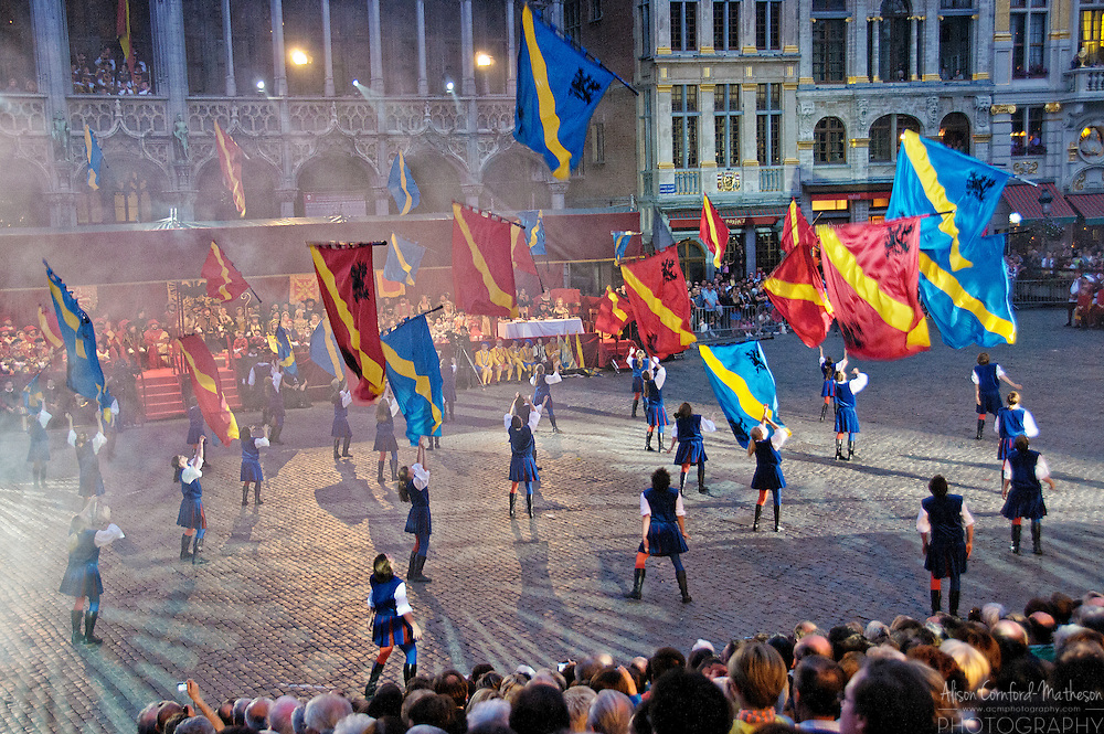 Flag throwers preform at the Ommegang Medieval Festival in the Grand Place of Brussels, Belgium