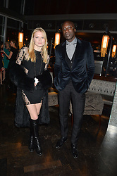 KATIA ELIZAROVA and OZWALD BOATENG at the OMEGA VIP dinner hosted by Cindy Crawford and OMEGA President Mr. Stephen Urquhart held at aqua shard', Level 31, The Shard, 31 St Thomas Street, London, SE1 9RY on 10th December 2014.