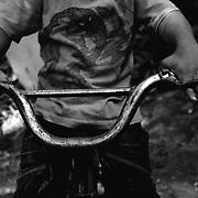 APUNTES SOBRE MI VIDA: LA PASTORA I - 2009/10<br /> Photography by Aaron Sosa<br /> Edgar Montillo, hijo de Maikel Montilla, uno de mis mejores amigos desde niño.<br /> La Pastora, Caracas - Venezuela 2009<br /> (Copyright © Aaron Sosa)