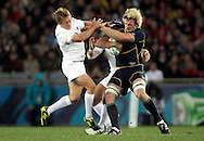 © Andrew Fosker / Seconds Left Images 2011 - England's Jonny Wilkinson (L) mixes it up with Scotland's Richie Gray - England v Scotland - Rugby World Cup 2011 - Eden Park - Auckland - New Zealand - 01/10/2011 -  All rights reserved..