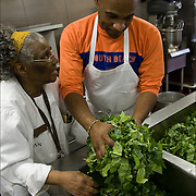 "Sister Jean with volunteer washing collard greens three times in kitchen sink, food for Thanksgiving being prepared a week in advance in Sister Jean's Kitchen. .A former casino chef, Webster, 74, found her calling when she saw a man rummaging through a garbage can in search of food. Now she runs a soup kitchen that feeds up to 400 homeless people a day, five days a week in the dinning room of the First Presbyterian Church of Atlantic City. No one is turned away. Jean has been called ""Sister Jean"" or ""Saint Jean"" or ""the Mother Teresa of Jersey."""