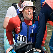 Ian Stewart/Yukon News<br /> JOURNEY'S END... Race Winner David Kelly winces as he pulls himself out of his kayak in Dawson City.
