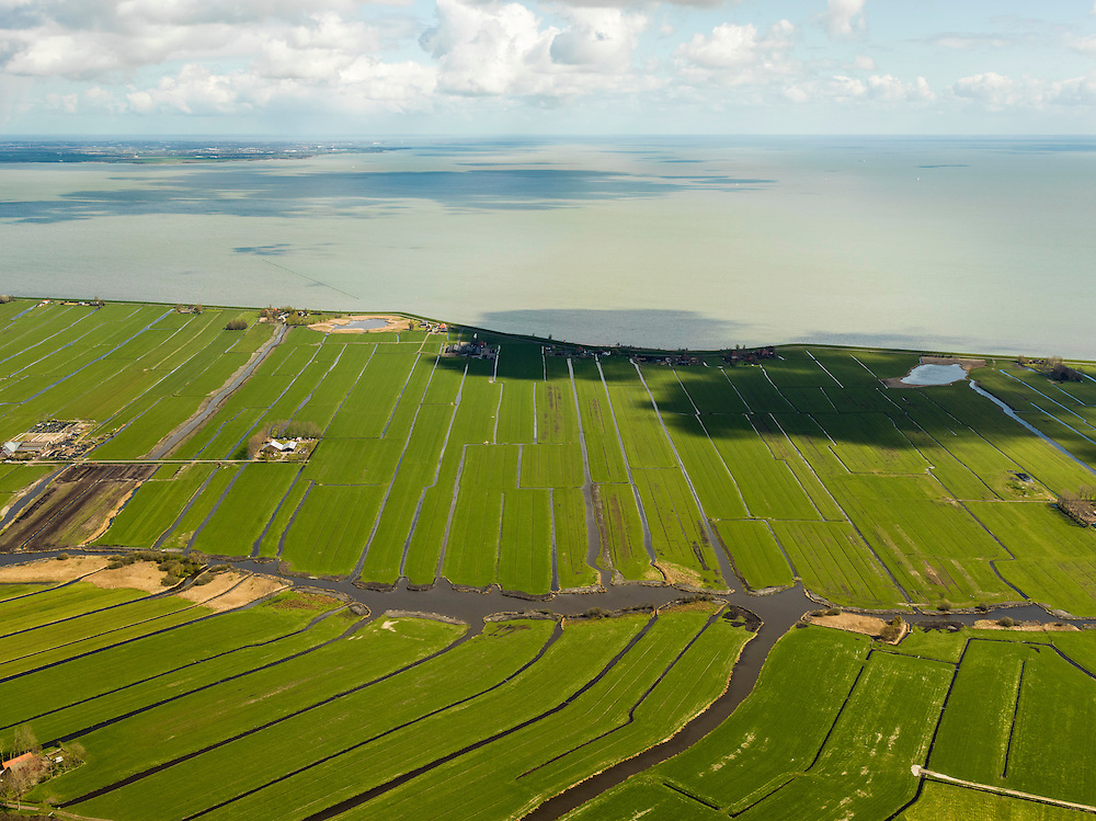 Nederland, Noord-Holland, Gemeente Edam - Volendam, 16-04-2012; Polder De Zeevang. Zeevangszeedijk met Moordenaarsbraak en Groote Braak (rechts), IJsselmeer op het tweede plan..Polder De Zeevang  a bog meadows area north of Amsterdam. Sea wall and IJsselmeer (lake). .luchtfoto (toeslag), aerial photo (additional fee required);.copyright foto/photo Siebe Swart
