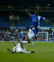 Photo: Andrew Unwin.<br />Leeds United v Cardiff City. Coca Cola Championship.<br />10/12/2005.<br />Cardiff's Cameron Jerome (R) hurdles a challenge from Leeds' Dan Harding (L).