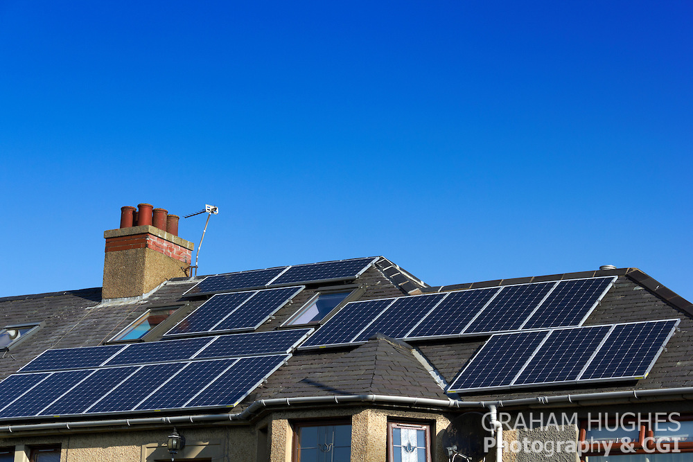 Terraced house with solar panels on roof.