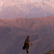 A fighter at the base of the Hindu Kush mountains in October 2001.