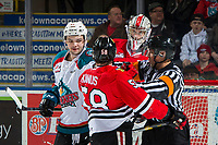 KELOWNA, CANADA - MARCH 2: Schael Higson #21 of the Kelowna Rockets gets in the face of Clay Hanus #58 of the Portland Winterhawks during second period  on March 2, 2019 at Prospera Place in Kelowna, British Columbia, Canada.  (Photo by Marissa Baecker/Shoot the Breeze)