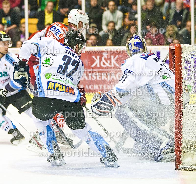 28.09.2012, Stadthalle, Klagenfurt, AUT, EBEL, EC KAC vs SAPA Feherva, 7. Runde, im Bild Tyler Metcalfe (HUN/CAN SAPA Fehervar, #10), Viktor Tokaji (HUN, SAPA Fehervar #32), Adam Murno (HUN, SAPA Fehervar, #51), Mike Siklenka (Kac, #23) during the Erste Bank Icehockey League 7th Round match betweeen EC KAC and SAPA Fehervar at the City Hall, Klagenfurt, Austria on 2012/09/28. EXPA Pictures © 2012, PhotoCredit: EXPA/ Mag. Gert Steinthaler