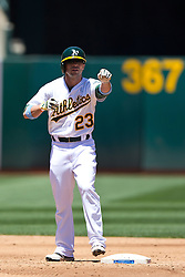 OAKLAND, CA - JUNE 21:  Sam Fuld #23 of the Oakland Athletics stands on second base after hitting a double against the Los Angeles Angels of Anaheim during the third inning at O.co Coliseum on June 21, 2015 in Oakland, California. The Oakland Athletics defeated the Los Angeles Angels of Anaheim 3-2. (Photo by Jason O. Watson/Getty Images) *** Local Caption *** Sam Fuld