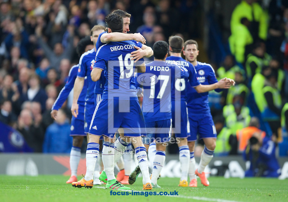 Diego Costa (19) of Chelsea celebrates after scoring the opening goal with Gary Cahill during the FA Cup match at Stamford Bridge, London<br /> Picture by Alan Stanford/Focus Images Ltd +44 7915 056117<br /> 21/02/2016