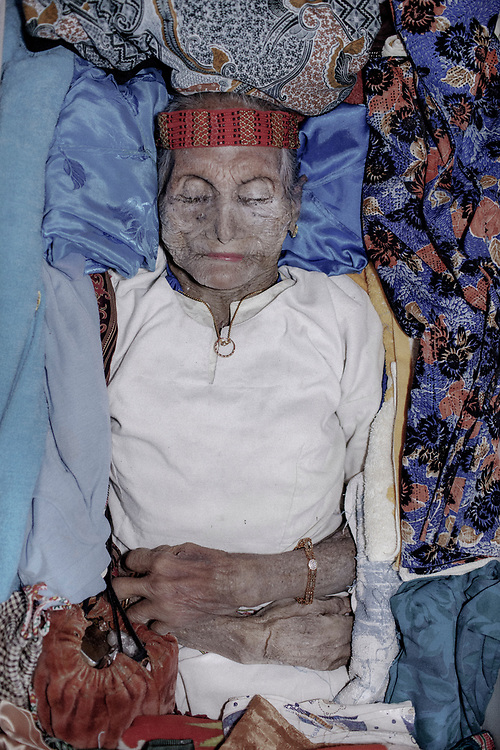 In Torajan culture, death is not necessarily the end. The body of Lai' Tiku who passed on a few months ago is seen inside the coffin.  Many of her personal belongings are placed inside to accompany her in the after life. The matriarch in her family, Nenek Lai' Tiku passed away at age 102, she is survived by 10 children, 49 grandchildren, and 162 great-grandchildren.