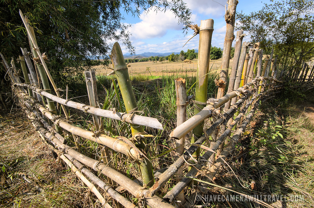 The corner of a fence made of bamboo around a rice field near Site 3 at the Plain of Jars, Laos.