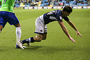 Ben Marshall of Millwall is tackled by Nathaniel Mendez-Laing of Cardiff City during the EFL Sky Bet Championship match between Millwall and Cardiff City at The Den, London, England on 9 February 2018. Picture by Toyin Oshodi.