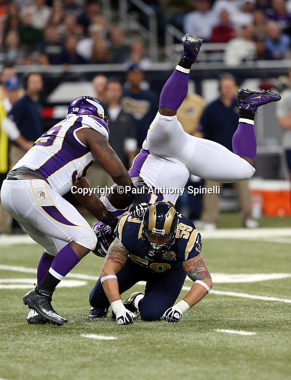 St. Louis Rams center Robert Turner (59) upends Minnesota Vikings defensive tackle Fred Evans (90) whose feet are straight up in the air on the play during the NFL week 15 football game against the Minnesota Vikings on Sunday, Dec. 16, 2012 in St. Louis. The Vikings won the game 36-22. ©Paul Anthony Spinelli