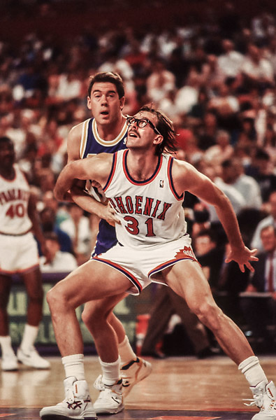 PHOENIX - APRIL 6:  Kurt Rambis #31 of the Phoenix Suns waits for a rebound during an NBA game against the Los Angeles Lakers played on April 6, 1990 at the Arizona Veterans Memorial Coliseum in Phoenix, Arizona.  Behind Rambis is Mark McNamara of the Lakers.  (Photo by David Madison/Getty Images) *** Local Caption *** Kurt Rambis