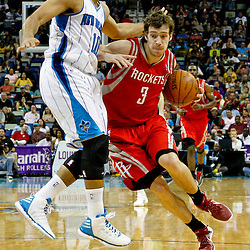 April 19, 2012; New Orleans, LA, USA; Houston Rockets point guard Goran Dragic (3) drives past New Orleans Hornets shooting guard Eric Gordon (10) during the second half at the New Orleans Arena. The Hornets defeated the Rockets 105-99.   Mandatory Credit: Derick E. Hingle-US PRESSWIRE